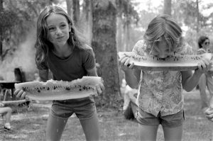 Girls competing in a watermelon eating contest